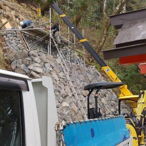上段石積み工
